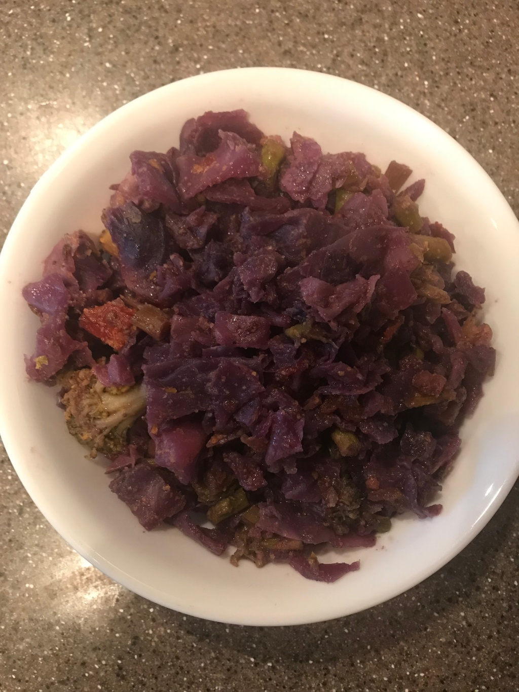 Purple cabbage and broccoli in a bowl